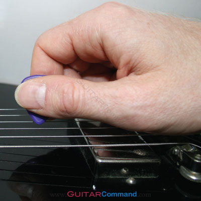 How To Hold A Guitar Pcik